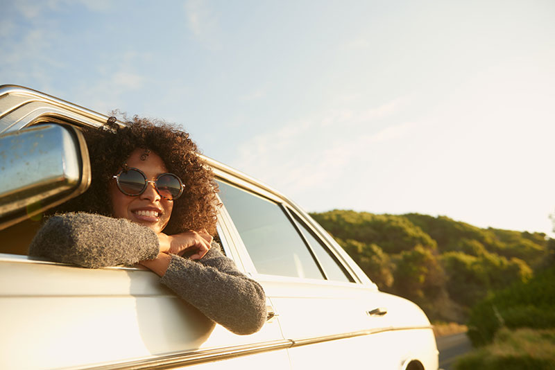 Woman Leaning Out of Car - Personal Insurance Ontario - DG Bevan Insurance Brokers