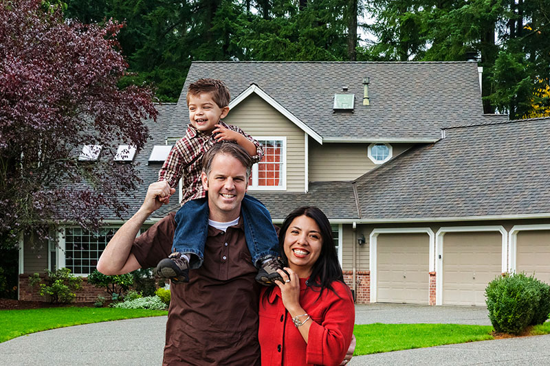 Father, Mother & Son Standing Outside of Their Home - Home Insurance Ontario - DG Bevan Insurance Brokers
